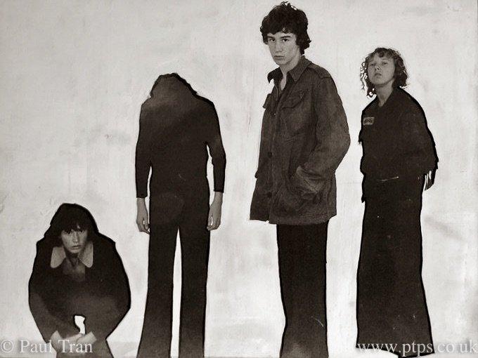 four teenage boys posing as a rock band album cover