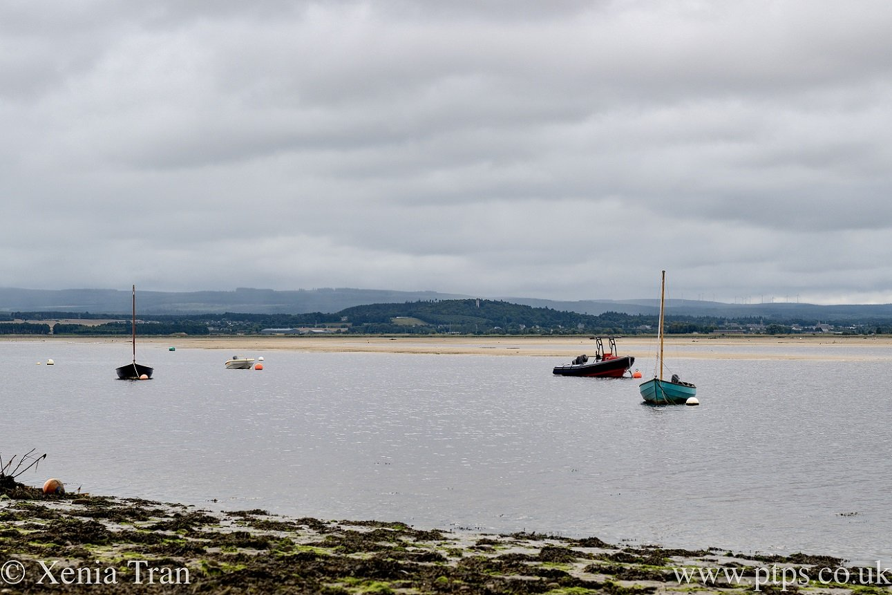 small boats anchored in Findhorn Bay at low tide
