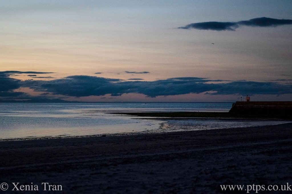 last light over the Moray Firth with an orange glow over the water